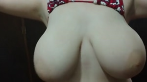 Playing with her big tits