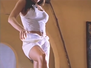 Carmen Electra pouring milk all over her sexy body in the film