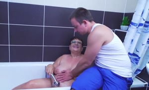 Granny gets fucked after shower with a young stallion